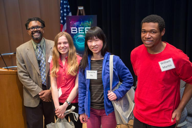 Ben Walker served as the judge for the 2014 Washington, DC Regional Brain Bee. Winners, from left to right: Arianna DiGregorio in second place; Suzanne Xu in first place; and William Martin in third place.