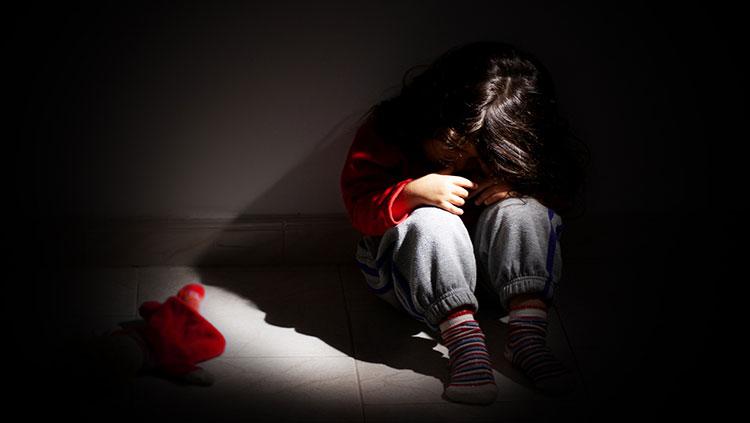 Girl sitting alone in the dark