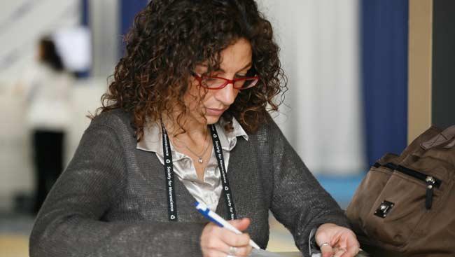 A female focuses on work.