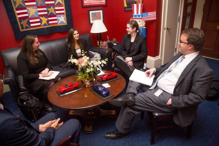 people sitting around a table at a meeting during the 2018 Capitol Hill Day event