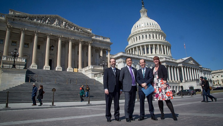 Advocates pose in front of the US Capitol