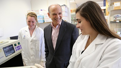 Dr. Eric Nestler in a lab with Associate Researchers Marie Doyle and Dominika Burek