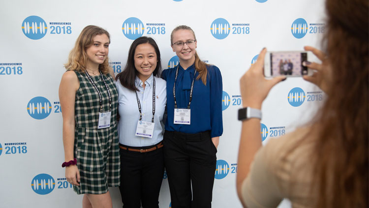 Three student members pose for a photo at Neuroscience 2018