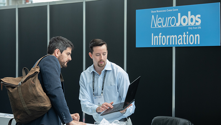 Two people at the NeuroJobs information booth