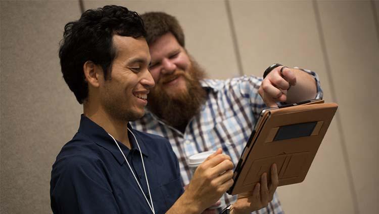 Members looking at tablet
