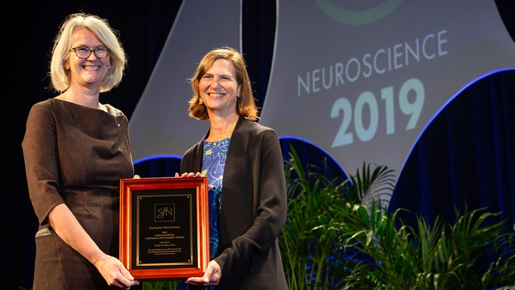 Hollis T. Cline, PhD (right), of the Scripps Research Institute, is honored with the Mika Salpeter Lifetime Achievement Award