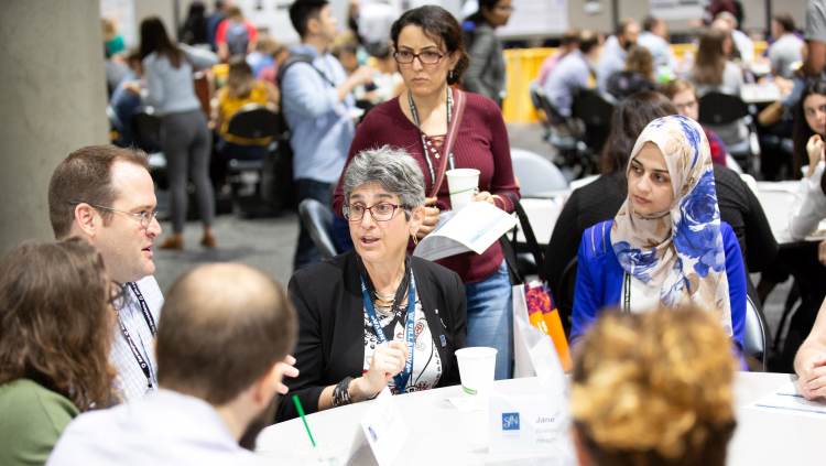 Neuroscience 2018 attendees sitting around a table at a training event