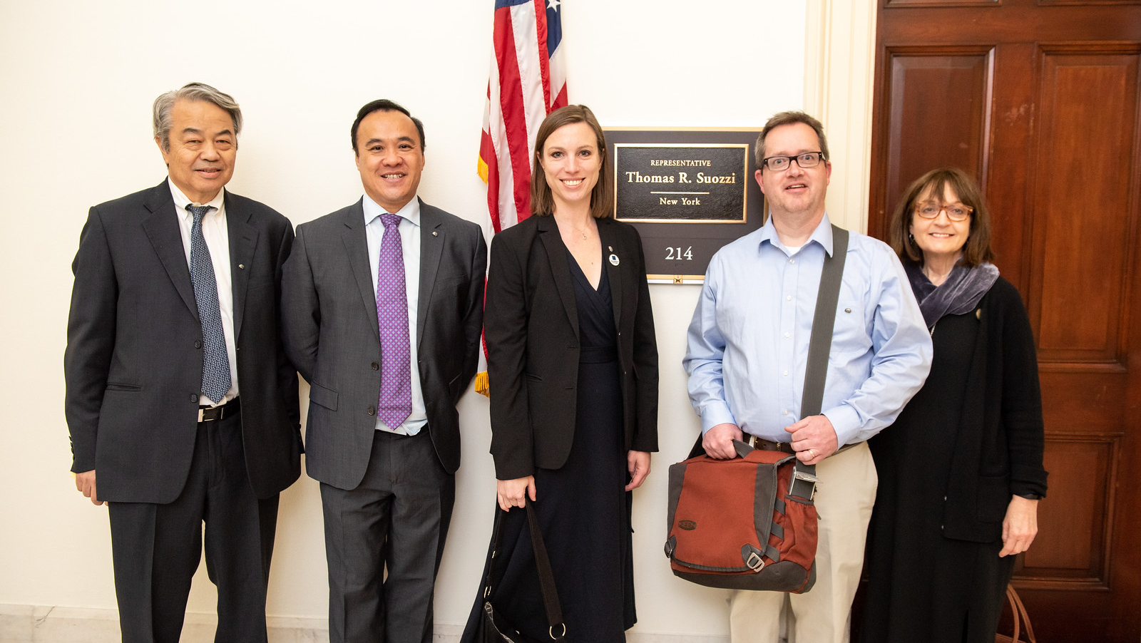 "Government and Public Affairs Committee Chair Moses V. Chao (left), along with SfN advocates and GPA members (left to right) Wai ""Ho"" Yu, Abigail Kalmbach, Steven Shea, and Helen Mayburg, pose outside Rep. Tom Suozzi's (D-NY) office following their Capitol Hill Day meeting."