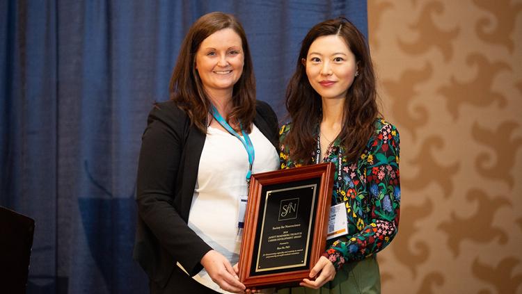 Biyu He, PhD, of NYU Langone Medical Center, accepts the Janett Trubatch Career Development Award.