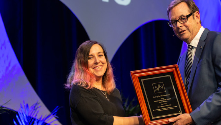 Elena Blanco Suarez, PhD, of the Salk Institute for Biological Studies, accepts the Next Generation Award at the junior faculty level.