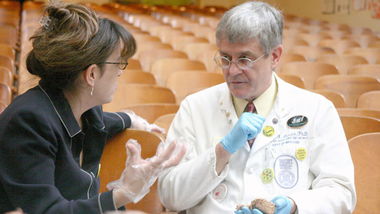 Dr. Paul Aravich from Eastern Virginia Medical School holding a brain model