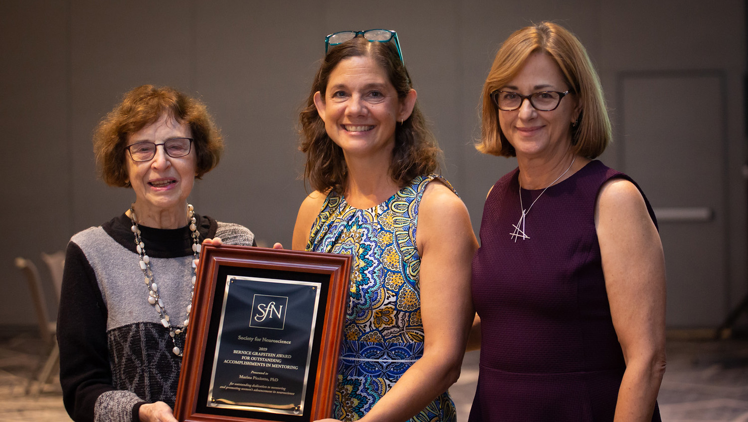 Marina Picciotto, PhD (center), of Yale University, is honored with the Bernice Grafstein Award for Outstanding Accomplishments in Mentoring.
