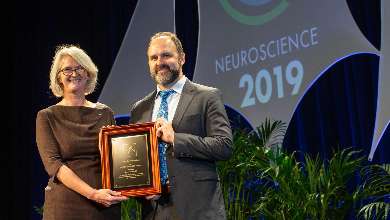 Thomas Kash, PhD (right), of the University of North Carolina Chapel Hill, accepts the Jacob P. Waletzky Award