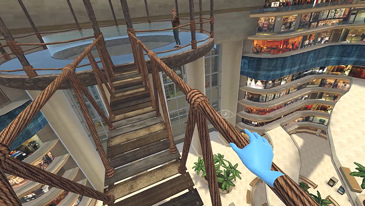 Oxford VR's immerse therapy uses a computer-generated virtual coach to reduce the fear heights in patients. Pictured here is the virtual environment where a patient practices walking across a rope bridge at a high elevation.