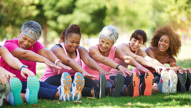 Image of elderly women stretching in the park